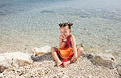Kind am Strand, Losinj